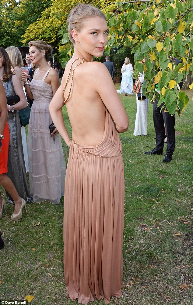 Goddess-like: Arizona Muse flashed her back in a nude, Grecian style gown, complete with with gold rope detailing