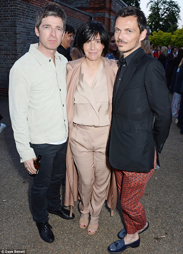 Working the room: Singer Sharleen and designer Matthew were seen chatting to Noel Gallagher at the outdoor event
