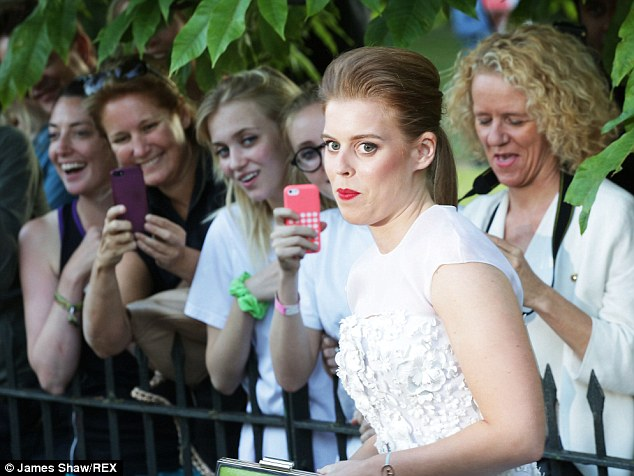 Snap happy: Fans lined the fences to take photos of Princess Beatrice as she arrived