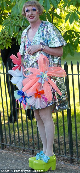 Colourful: Grayson Perry showed off her eccentric style in green platforms and a sparkly dress, complete with flowers