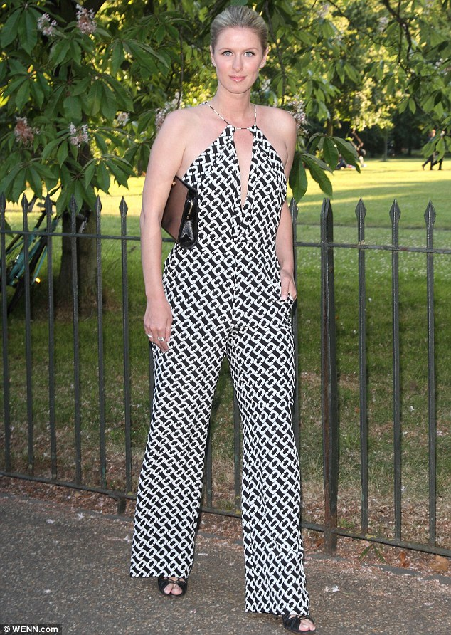 Monochrome: Nicky Hilton kept her pins covered in a plunging patterned jumpsuit, while her blonde tresses with tied back