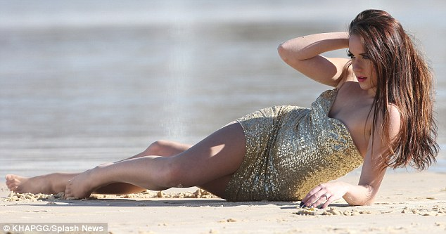 Strike a pose: The brunette beauty stretched out on Bondi's famous sand for the shoot