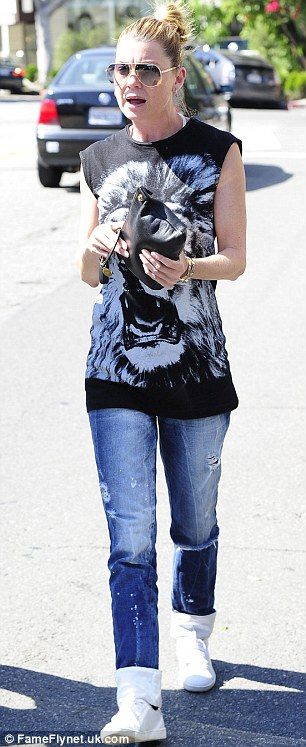 Fine form: Ellen was looking great for a 44-year-old as she enjoyed a stroll in the summer sunshine