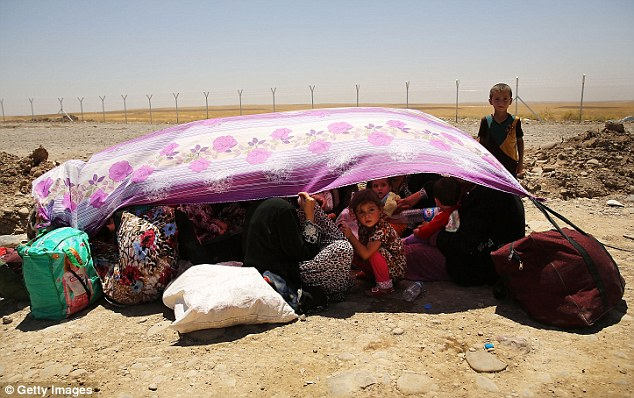 More than 1,000 Iraqis have fled the cities of Mosul and Tal Afar after they were overun with ISIS militants