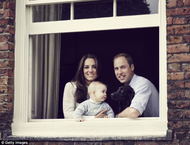 Happy family: The Duke and Duchess of Cambridge with their baby son, and the couple's dog Lupo