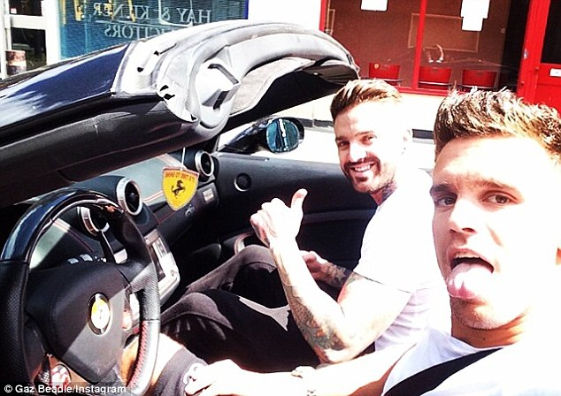 Car fan: Last month, the star posted this snap in his Ferrari, writing: 'Sun shining cruising with @arroncgshore'