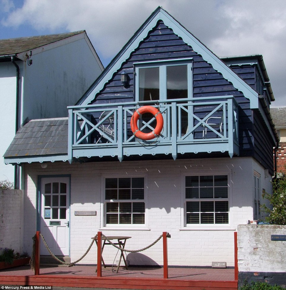 The one-bedroom Sea Horse Cottage, in Aldeburgh, Suffolk, is for sale for £475,000 which features a balcony as well as a raised timber deck