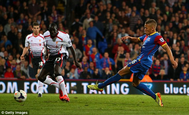 Rapid rise: Dagenham and Redbridge were given £1million after Dwight Gayle (right) joined Crystal Palace