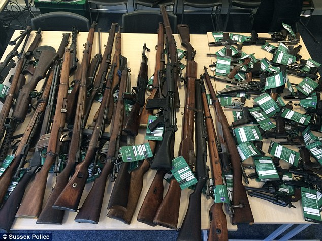 Haul: Thinking they would find 'two or three' weapons, police in Brighton were astonished to discover 30 rifles, 40 handguns and a Second World War grenade in a routine search of a dead man's house in suburban Brighton