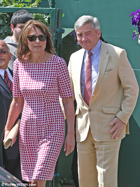 Mrs Middleton looked elegant in a well-cut red and white houndstooth dress, while her husband wore a cream suit and tie