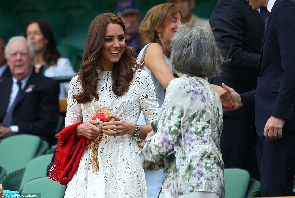 The forecast for SW19 was dry and bright but Kate carried a bright red pashmina in case temperatures dropped later