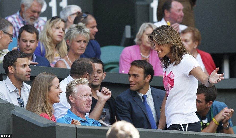 The women in Murray's life: Kim Sears chatted to her boyfriend's new coach, Amelie Mauresmo, in the players' box before the match