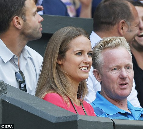 Kim Sears was all smiles at first as she settled down to watch her boyfriend's match