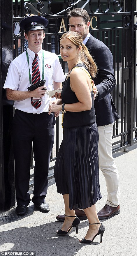 The couple were smartly dressed as they made their way into the All England Club