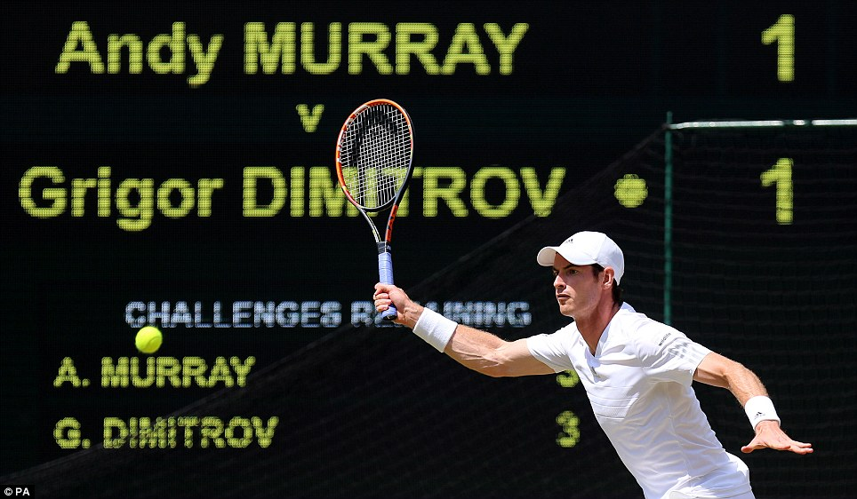 Tense match: Murray is pictured focused in action against old friend and now rival Dimitrov during day ten of the Wimbledon