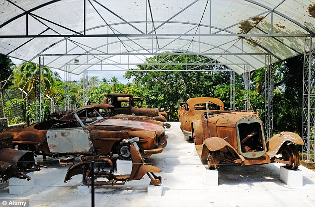 Museum: Burnt-out cars are on display at the ranch which now has exhibitions dedicated to the drug kingpin