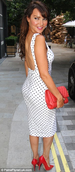 Brunette beauty: Lizzie Cundy added some additional colour to the evening in a pair of red heels and a matching handbag
