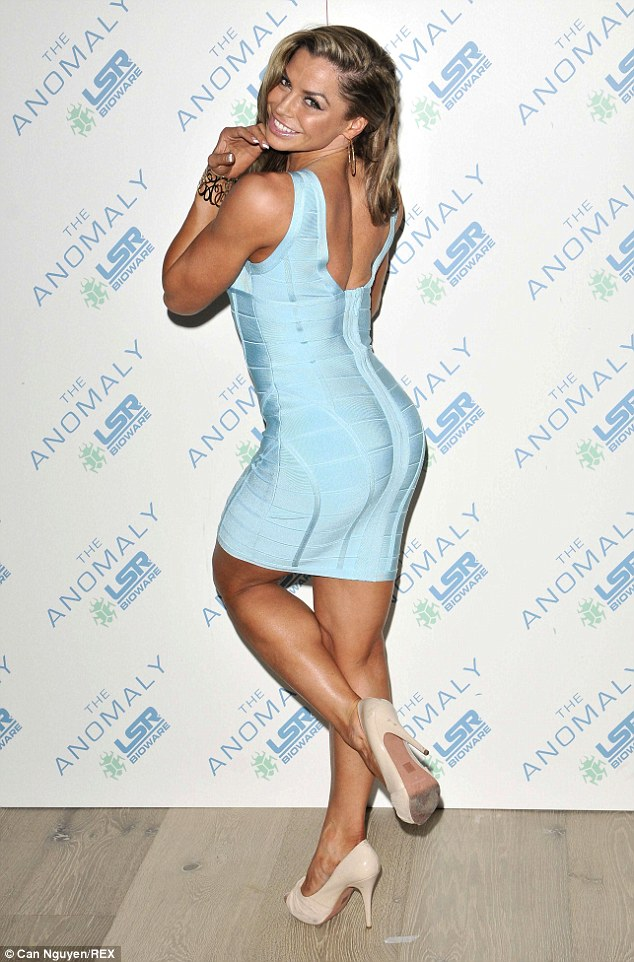 Shoulder shot: Louise Glover also had her tanned pins on show in a striking blue bandage dress