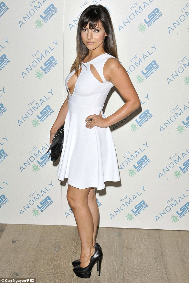 Raven-haired beauty: Roxanne Pallett wowed in a pretty cut-out white dress as she stepped out at the Ham Yard Hotel in London for the film premiere for new sci-fi action movie The Anomaly on Tuesday night