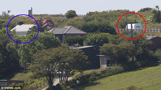 So close: His farmhouse, circled in blue, lies 30 yards from the power lines he wants to be connected to