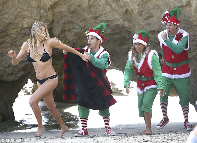 Run, LeAnn, Run: She escapes and is seen running from Santa's little helpers as they manage to remove her robe which reveals her black bikini