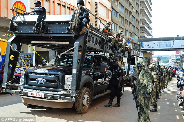 """UPDF soldiers and police forces patrol streets in Kampala with a tactical operation vehicle on July 3 2014 after the US embassy in Uganda warned Thursday of a """"specific threat"""" by an unknown group to attack Entebbe international airport, which serves the capital Kampala. The alert came as travellers flying to the United States from Europe and the Middle East faced tighter security because of new concerns about the development of explosives that could circumvent airport security. AFP PHOTO/ PETER BUSOMOKEPETER BUSOMOKE/AFP/Getty Images"""