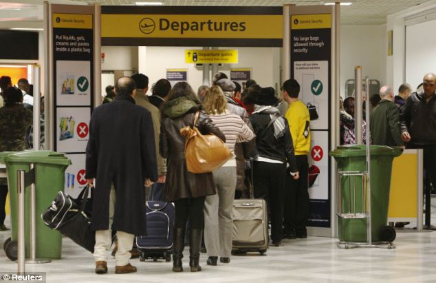 Delayed: The new measures are likely to lead to longer queues, delays and increased checks at airports, as well as an influx of sky marshals on some transatlantic routes