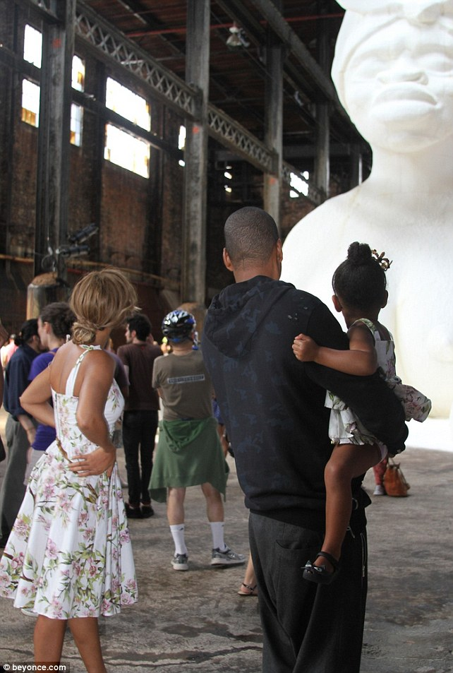 Another subliminal? Beyonce shared a family photo of her with Jay-Z and Blue Ivy on her website on Wednesday. In it, the family look at a giant art installation