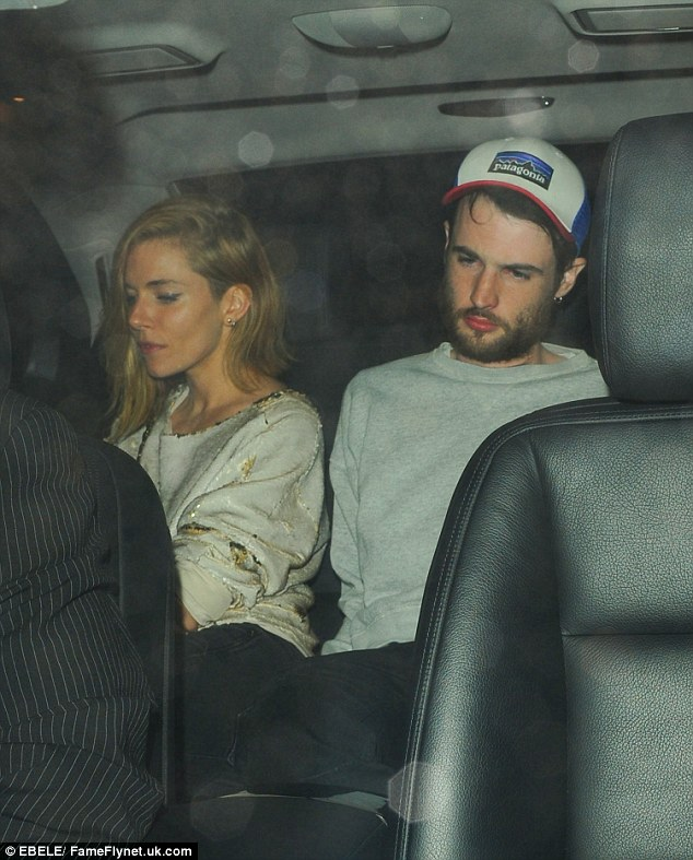 Laid-back: Sienna Miller and her fiancé Tome Sturridge made a low-key arrival to enjoy a date night together