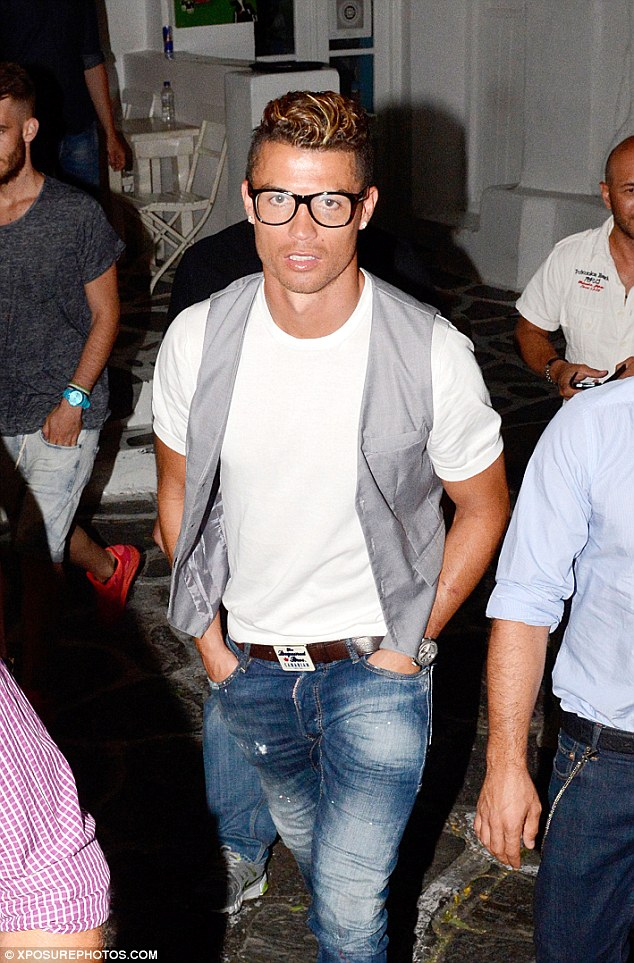 Time off: Irina's footballer beau, Cristiano Ronaldo, was seen enjoying his time off from training with friends in Greece