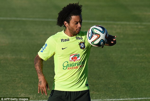 Eyes on the prize: Brazil's Real Madrid left back Marcelo balances the ball with the top of his hand