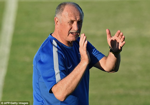 Not impressed: Brazil coach Luiz Felipe Scolari has told his team's critics to 'go to hell'