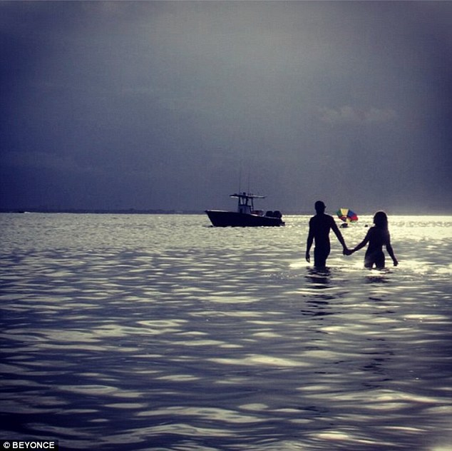 No issues here! In the other picture, she and presumably Jay Z are seen as silhouettes in the distance, holding hands as a small boat cruises by