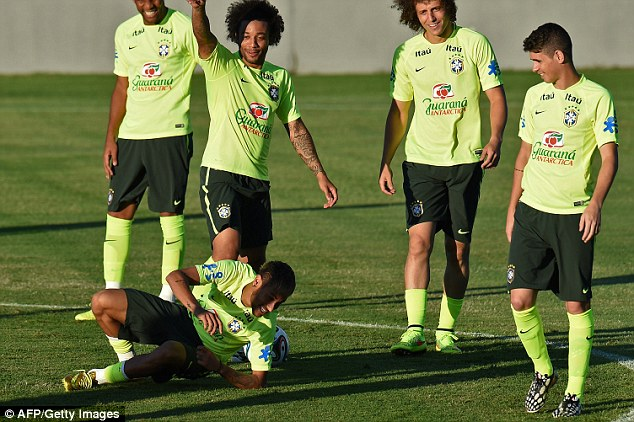 High spirits: Neymar falls to the ground with a smile on his face as Marcelo, David Luiz and Oscar look on