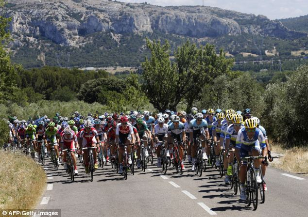 German entrant Marcel Kittel, 26, warned Yorkshire's roads could be too narrow for the Tour de France. He said the winding streets, enclosed by dry stone walls, were 'risky' for riders taking part in the opening stages. The peloton is pictured riding between Aix-en-Provence and Montpellier during last year's event