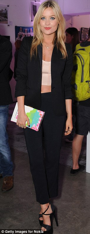 Effortless: Laura flashed her tum in a nude crop top (R)
