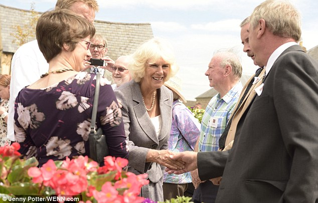 Blooming lovely: Camilla, Duchess of Cornwall meets locals at the 50th Anniversary of RHS Britain in Bloom at Usk, Monmouthshire