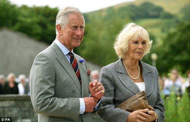 Remembering: The Prince of Wales and Duchess of Cornwall during a visit to the Welsh National Mining Memorial, Senghenydd, where they paid their respects to those who lost their lives in the coal mines