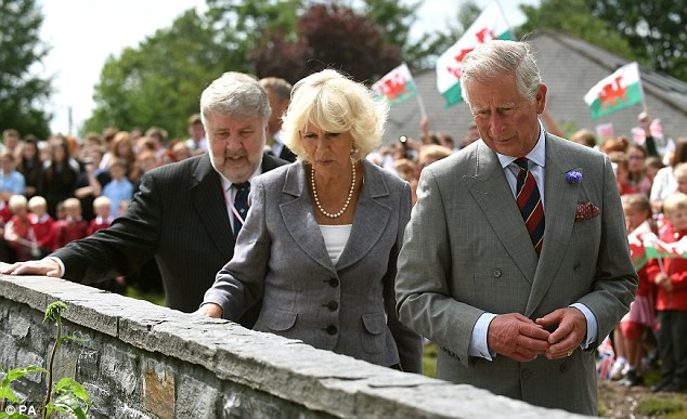 Tribute: The Prince of Wales and Duchess of Cornwall view the names of miners engraved into the stones