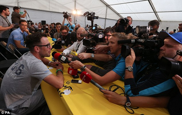 Centre of attention: Cavendish is mobbed by the media during a press conference