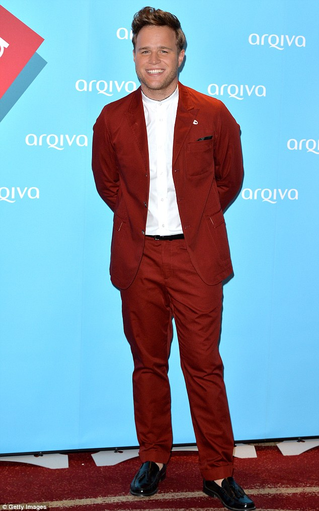 Lad in red: Olly Murs wore a bright scarlet suit to the ceremony
