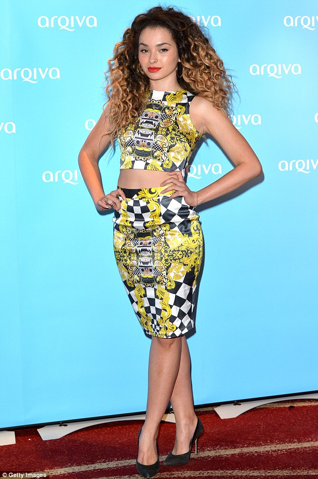 Stand out: Ella Eyre wears a graphic print crop top and skirt to attend the Arqiva Commercial Radio Awards