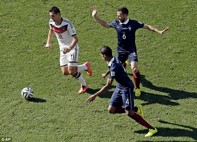 Shackled: Varane prevented World Cup specialist Miroslav Klose from scoring, but the damage was done