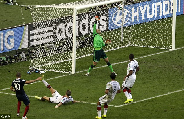 Au revoir: Neuer's fine save from Benzema was France's last chance of the game as Germany held out
