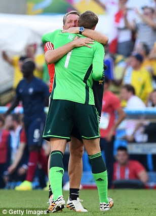 Embrace: Germany's goalkeeper coach Andreas Koepke hugs Neuer after the final whistle at the Maracana
