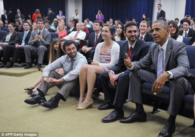 U.S. President Barack Obama watches the World Cup match between the USA and Belgium with White House staffers