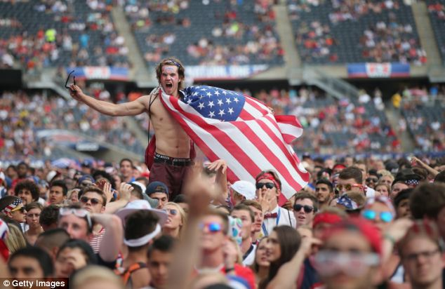 Fans watch the game between the U.S. and Belgium in Chicago, Illinois. Organisers said 28,000 people turned up to watch the match at Soldier Field
