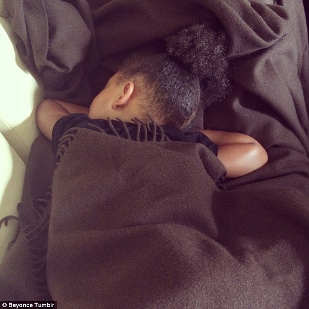 Snug as a bug in a run: Blue is seen sleeping in another snap posted by her superstar mother