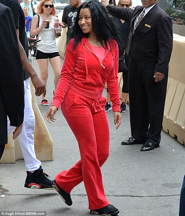 Comfortable customer: Nicki Minaj looked relaxed as she was seen leaving her hotel room on Thursday for another rehearsal. This time in a red Juicy Couture tracksuit