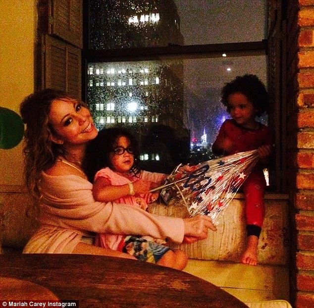 Staying warm inside: The mother-of-two shared a snap cosying up with her three-year-old twins, Monroe and Moroccan, while it rained and thundered in New York City on Thursday